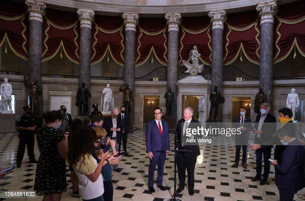 White House Chief of Staff Mark Meadows and Secretary of the Treasury Steven Mnuchin speak to members of the press after a meeting at the office of...