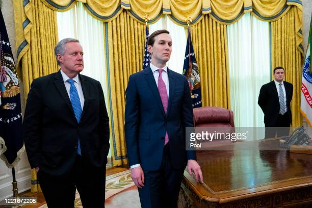 White House Chief of Staff Mark Meadows and senior advisor Jared Kushner listen as US President Donald Trump meets with Florida Gov Ron DeSantis in...