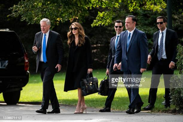White House Chief of Staff Mark Meadows, Hope Hicks, Nicholas Luna, Dan Scavino and John McEntee follow President Donald J. Trump as he walks to...