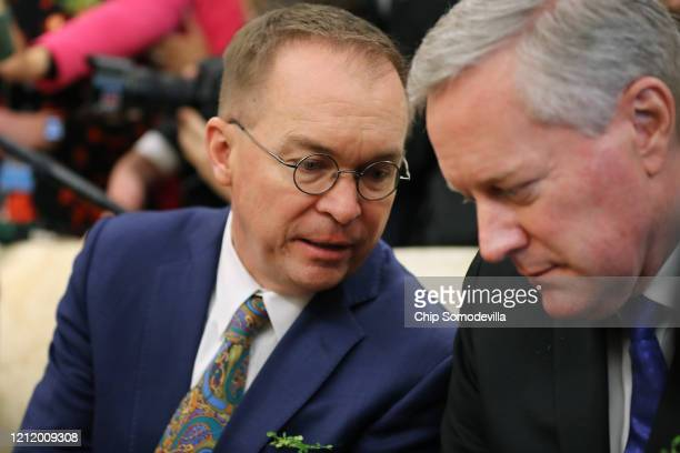 White House Chief of Staff Mark Meadows listens to his predecessor Special Envoy for Northern Ireland Mick Mulvaney as US President Donald Trump and...