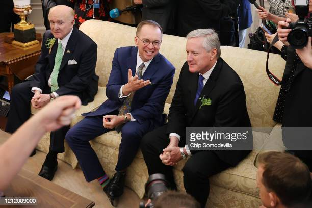 White House Chief of Staff Mark Meadows talks with his predecessor Special Envoy for Northern Ireland Mick Mulvaney as US President Donald Trump and...