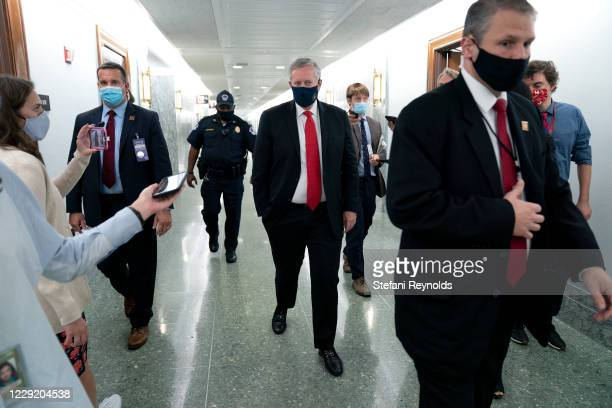 White House Chief of Staff Mark Meadows wears a protective mask as he departs the Senate Republican policy luncheon in the Hart Senate Office...
