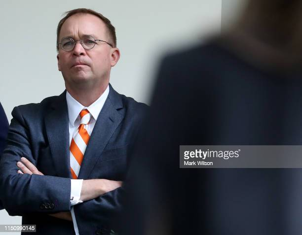 White House Chief of Staff Mick Mulvaney listens to President Donald Trump speak about Robert Mueller's investigation into Russian interference in...