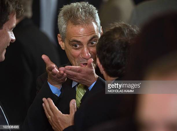 White House Chief of Staff Rahm Emanuel speaks to guests before US President Barack Obama spoke at a Lesbian Gay Bisexual and Transgender Pride Month...