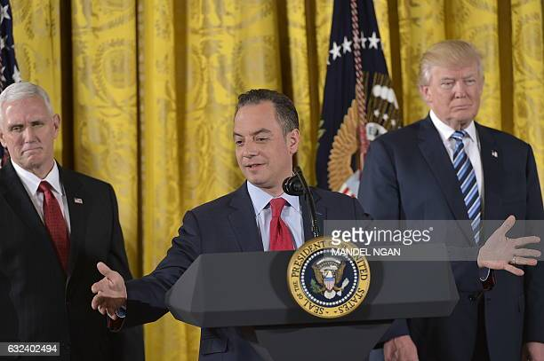 White House Chief of Staff Reince Priebus as US President Donald Trump and Vice President Mike Pence watch after the swearing in of the White House...