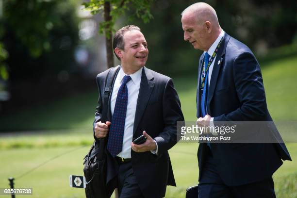 White House Chief of Staff Reince Priebus left and Director of Oval Office operations Keith Schiller right walk across the South Lawn to board Marine...
