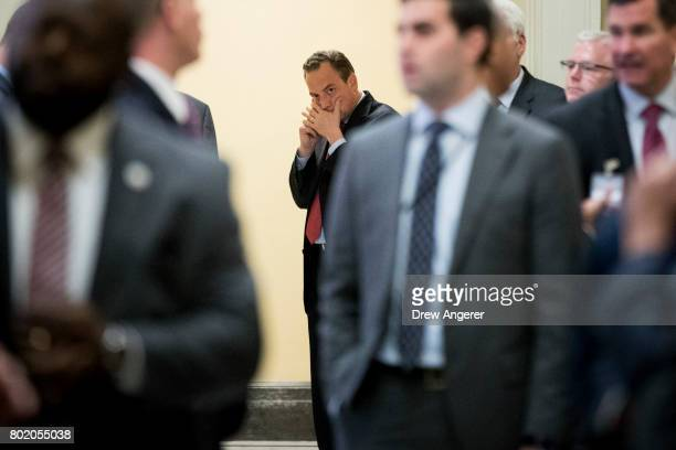White House Chief of Staff Reince Priebus talks on a cell phone before a closeddoor Senate GOP conference meeting on Capitol Hill June 27 2017 in...