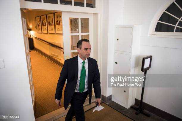White House Chief of Staff Reince Priebus walks out before President Donald Trump speaks about the US role in the Paris climate change accord in the...