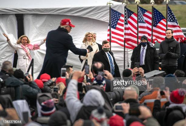 White House Chief spokesperson Kayleigh McEnany , dances along with U.S. President Donald Trump as Ivanka Trump , and Jared Kushner , look on...