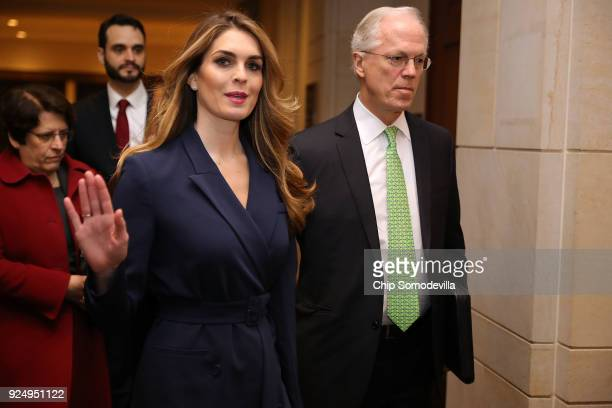 White House Communications Director and presidential advisor Hope Hicks waves to reporters as she arrives at the U.S. Capitol Visitors Center...