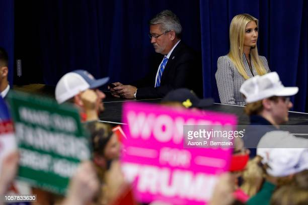 White House Communications Director Bill Shine and Ivanka Trump look on as President Donald Trump speaks during a campaign rally for Republican...