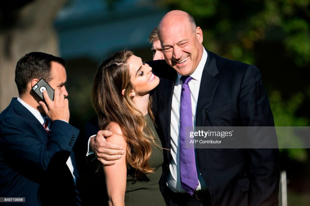 White House Communications Director Hope Hicks and National Economic Council Director Gary Cohn arrive on the South Lawn of the White House for a memorial service for the 9/11 terrorist attacks September 11, 2017 in Washington, DC. / AFP PHOTO / Brendan Smialowski