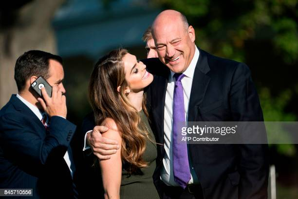 White House Communications Director Hope Hicks and National Economic Council Director Gary Cohn arrive on the South Lawn of the White House for a...