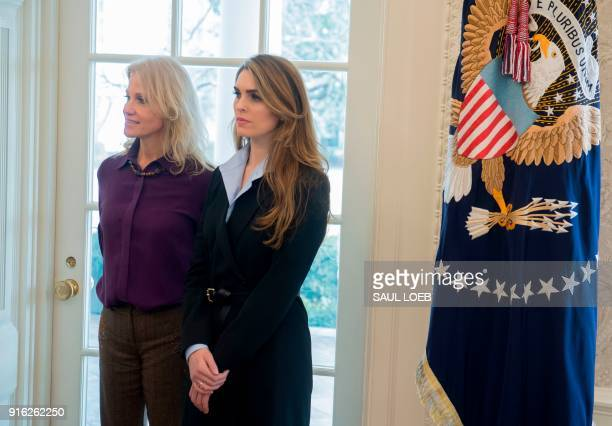 White House Communications Director Hope Hicks and White House Counselor Kellyanne Conway listen as US President Donald Trump speaks to the press in...