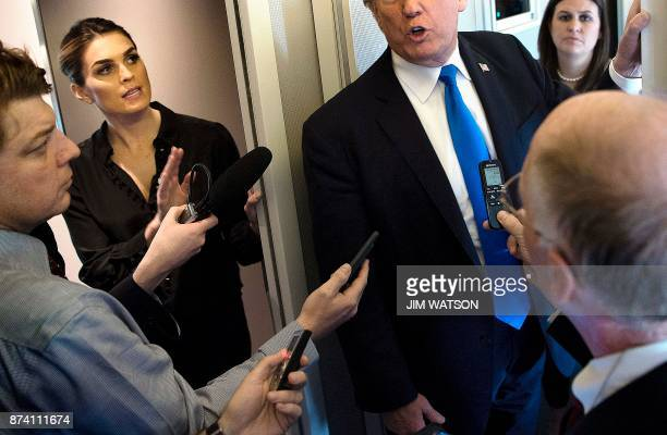 White House Communications Director Hope Hicks calls for no more questions as US President Donald Trump speaks to reporters aboard Air Force One...