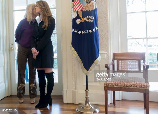 White House Communications Director Hope Hicks listens to White House Counselor Kellyanne Conway as US President Donald Trump speaks to the press in...