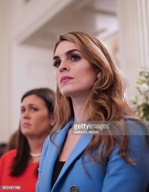 White House Communications Director Hope Hicks watches as US President Donald Trump takes part in a listening session on gun violence with teachers...