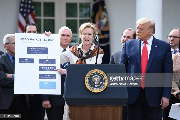 White House Coronavirus Response Coordinator Debbie Birx holds a flow chart as US President Donald Trump listens during a press conference on COVID19...