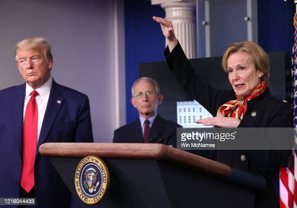 White House coronavirus response coordinator Debbie Birx speaks while flanked by President Donald Trump and Dr Anthony Fauci director of the National...