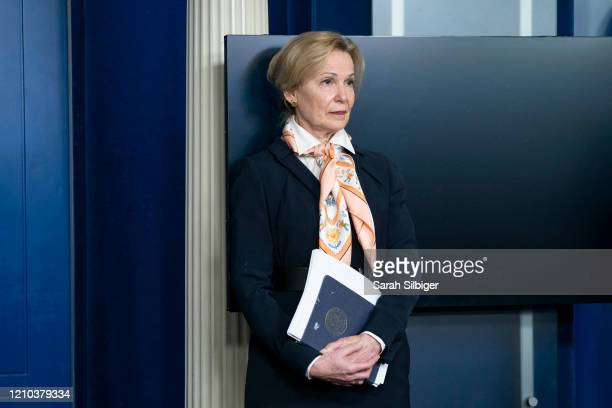 White House coronavirus response coordinator Deborah Birx listens as US President Donald Trump delivers remarks at a coronavirus press briefing on...