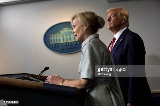 White House Coronavirus Response Coordinator Deborah Birx speaks as US President Donald Trump listens during a news briefing on the latest...
