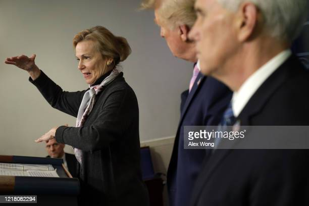 White House coronavirus response coordinator Deborah Birx speaks as US President Donald Trump and Vice President Mike Pence listen during the daily...