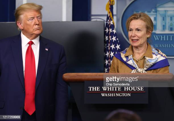 White House coronavirus response coordinator Deborah Birx speaks while flanked by US President Donald Trump following a meeting of his coronavirus...