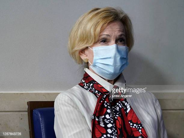 White House coronavirus task force coordinator Dr Deborah Birx listens to US President Donald Trump speak during a news conference about his...
