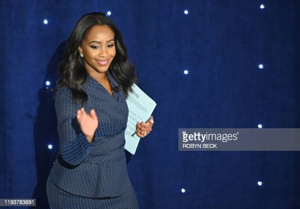 CNN White House correspondent Abby Phillip arrives on stage to moderate the seventh Democratic primary debate of the 2020 presidential campaign...