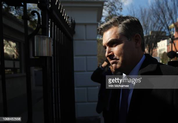 White House correspondent Jim Acosta arrives at the White House gate as he returns to work following a court ruling restoring his ability to report...