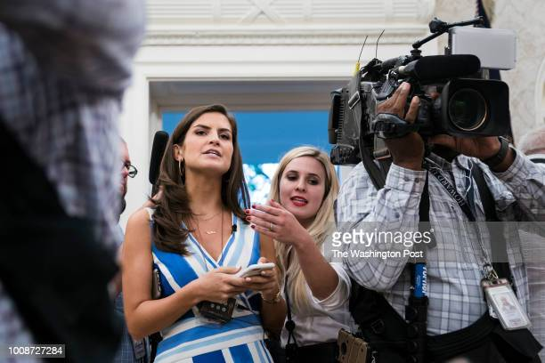White House Correspondent Kaitlan Collins asks questions of President Donald J Trump as the press is escorted out after a swearingin ceremony for the...