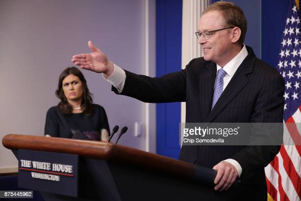 White House Council of Economic Advisers Chairman Kevin Hassett answers reporters' questions as Press Secretary Sarah Huckabee Sanders looks on in...