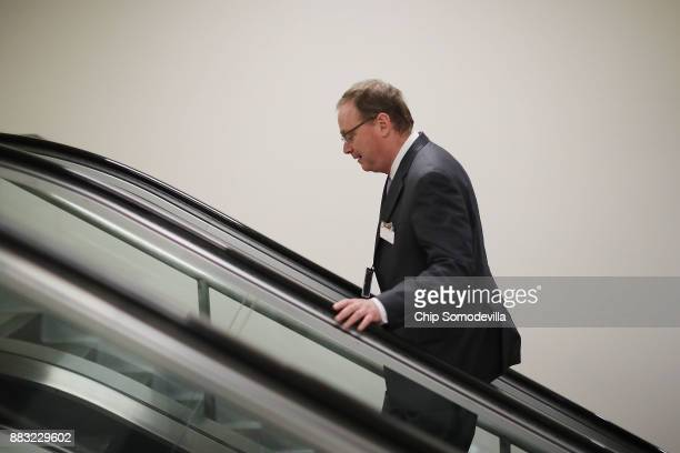 White House Council of Economic Advisers Chairman Kevin Hassett walks in the basement of the US Capitol November 30 2017 in Washington DC The Senate...