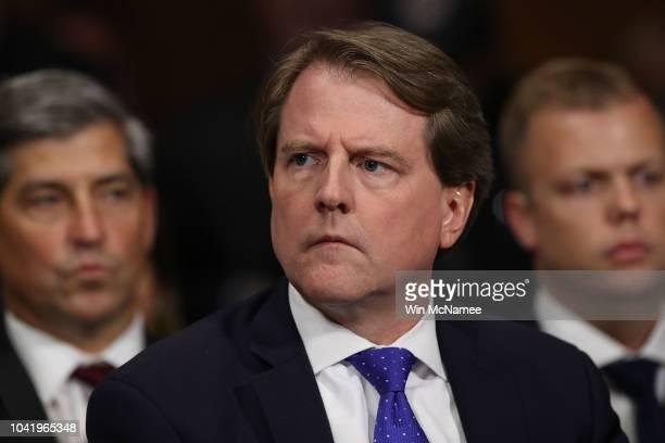 White House Counsel Don McGahn listens to Judge Brett Kavanaugh as he testifies before the Senate Judiciary Committee during his Supreme Court...