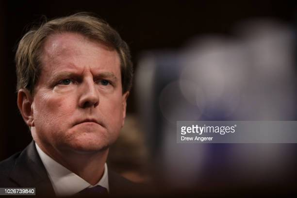White House Counsel Don McGahn looks on as Judge Brett Kavanaugh appears before the Senate Judiciary Committee during his Supreme Court confirmation...