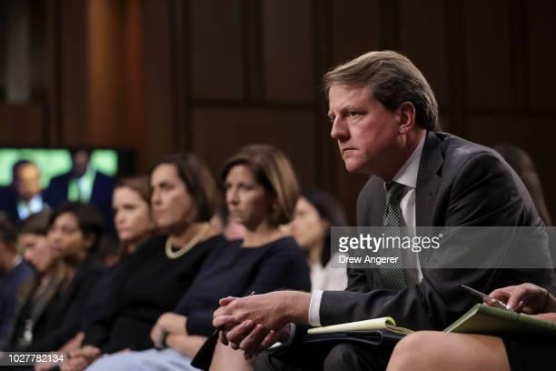 White House Counsel Don McGahn looks on as Supreme Court nominee Judge Brett Kavanaugh testifies before the Senate Judiciary Committee on the third...