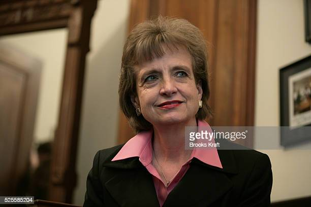 White House Counsel Harriet Miers meets with Senator Lindsey Graham while making the rounds visiting Senators on Capitol Hill in Washington October 6...