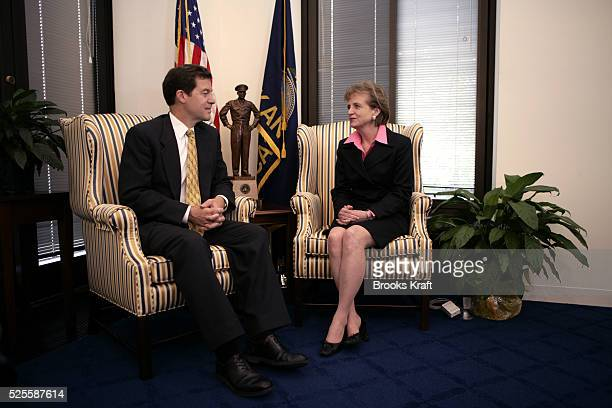 White House Counsel Harriet Miers meets with Senator Sam Brownback while making the rounds visiting Senators on Capitol Hill in Washington October 6...