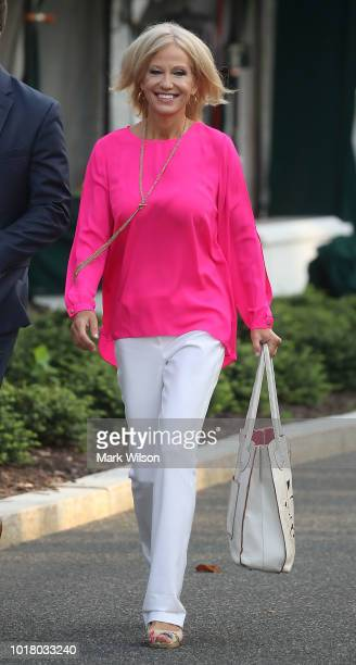 White House Counsel Kellyanne Conway walks away after appearing on a morning television show from the North Lawn of the White House on August 17 2018...