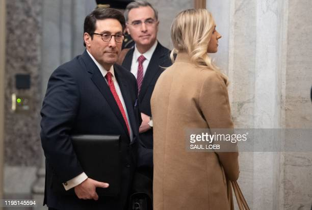 White House Counsel Pat Cipollone and attorney Jay Sekulow , members of US President Donald Trump's defense team, arrive for the Senate impeachment...