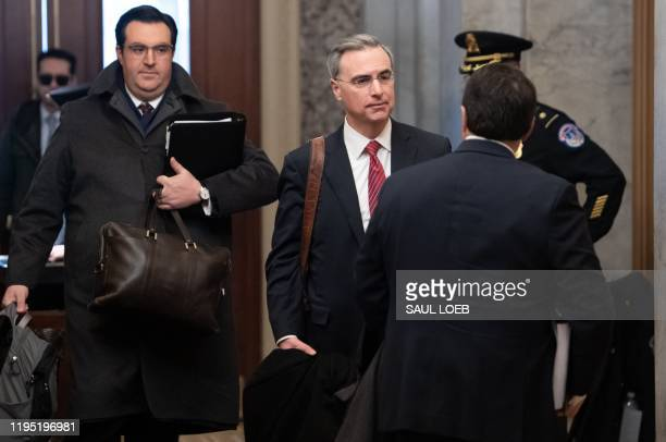 White House Counsel Pat Cipollone and attorney Jordan Sekulow , members of US President Donald Trump's defense team, arrive for the Senate...