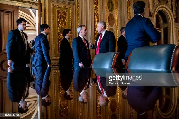 White House Counsel Pat Cipollone and Representative Mark Meadows as they leave their meeting room with the rest of President Donald Trumps defense...