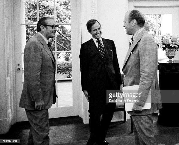 White House Counselor Dean Burch Republican National Committee Chairman George HW Bush and President Gerald Ford in the Oval Office 1974