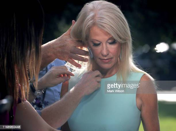 White House counselor Kellyanne Conway prepares to appear on a morning television show from the North Lawn of the White House on August 19 2019 in...