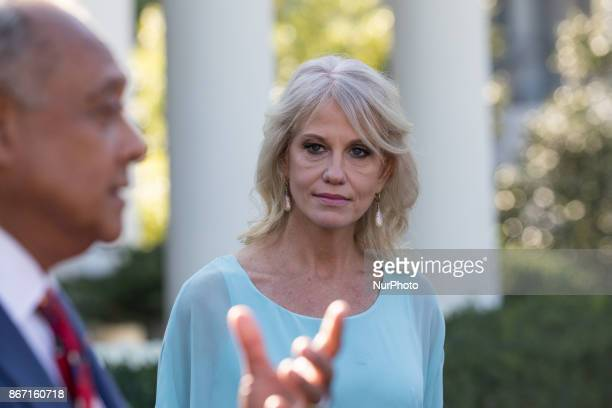 White House counselor Kellyanne Conway stands by as reporters speak to attendees of the event combatting drug demand and the opioid crisis outside...