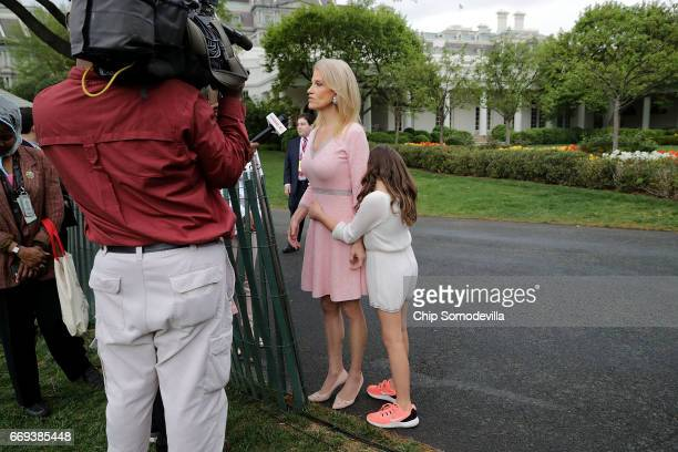White House Counselor to the President Kellyanne Conway is embraced by her daughter while being interviewed during the 139th Easter Egg Roll on the...