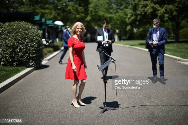 White House Counselor to the President Kellyanne Conway prepare to talk to reporters after three television interviews outside the White House May...