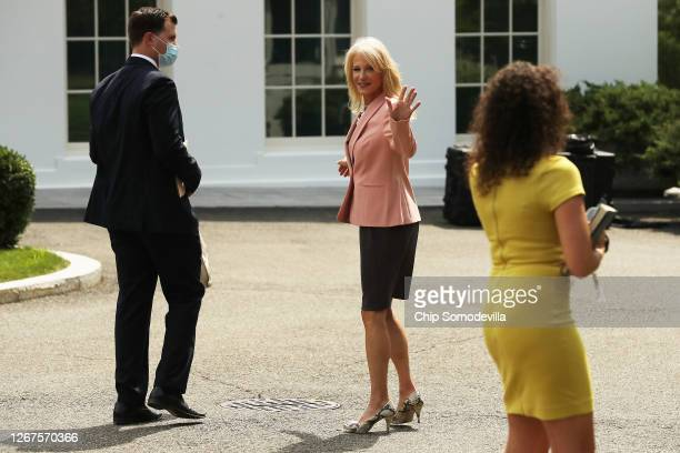 White House Counselor to the President Kellyanne Conway returns to the West Wing after talking to reporters outside the White House on August 21,...