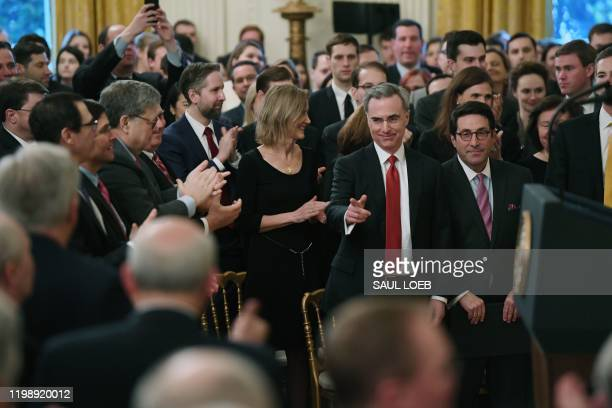 White House defense team lawyer Pat Cipollone stands to applause before US President Donald Trump speaks about his Senate impeachment trial in the...