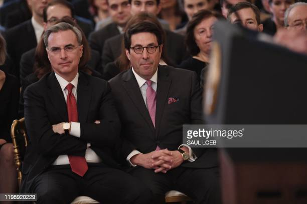 White House defense team lawyers Pat Cipollone and Trump's personal lawyer Jay Sekulow listen to US President Donald Trump as he speaks about his...